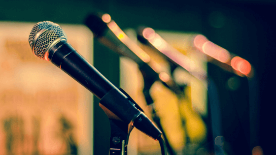 Image of multiple microphones on stage